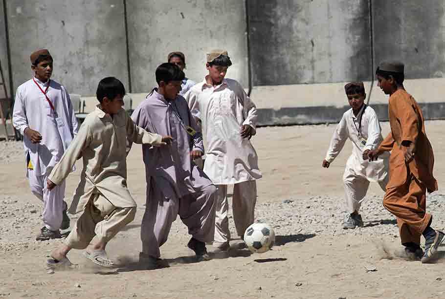 Afghan kids playing soccer