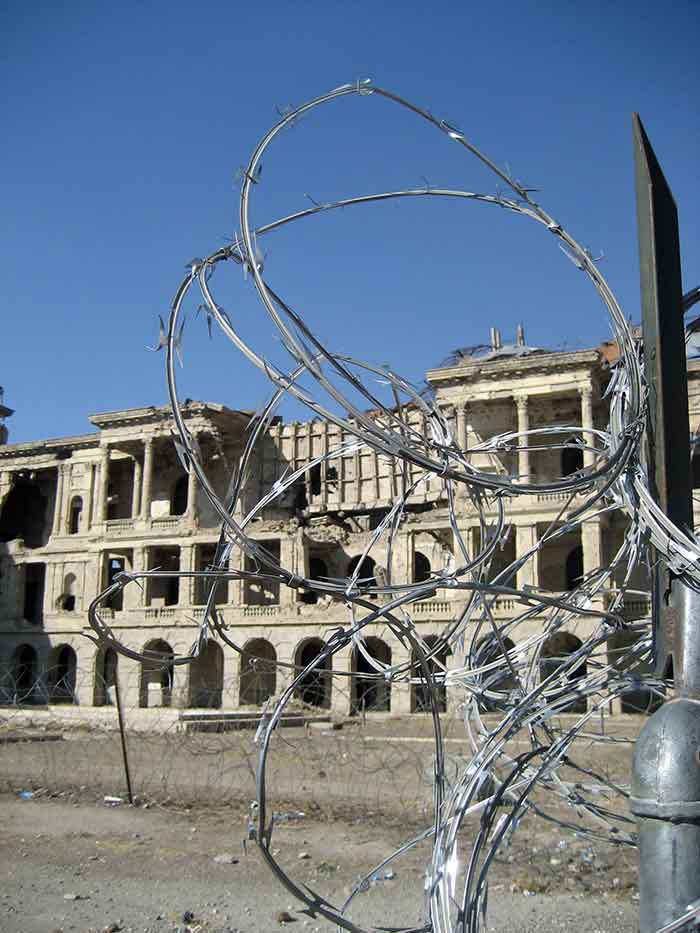 Razor wire near building