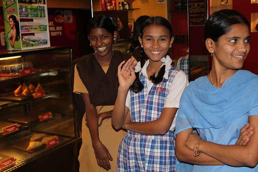 Karishma, Laxmi, and Kajal at coffee shop