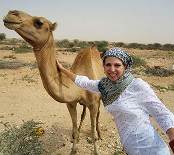 Dina petting camel in Somaliland