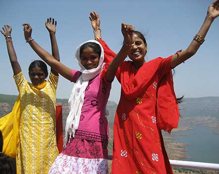 Indian girls with hands up
