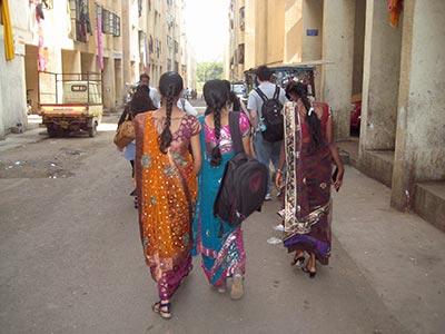 Indian girls walking in slum