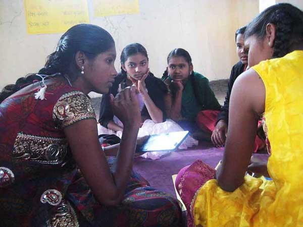 Teen teaching other teens