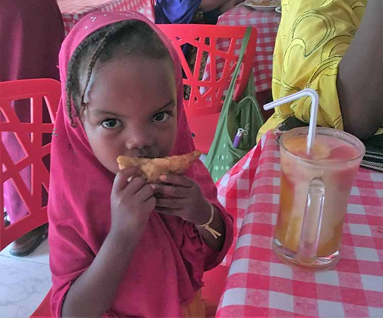 Girl eating sambusa