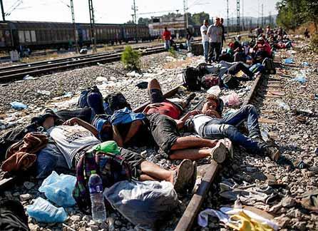 Syrian refugees sleeping on train tracks