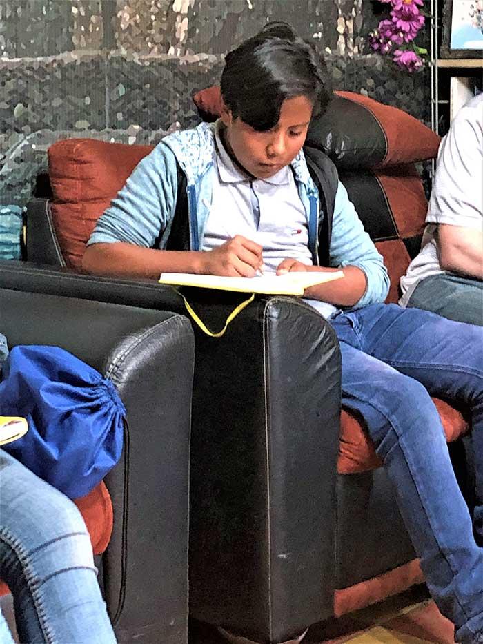 Guatemalan student taking notes