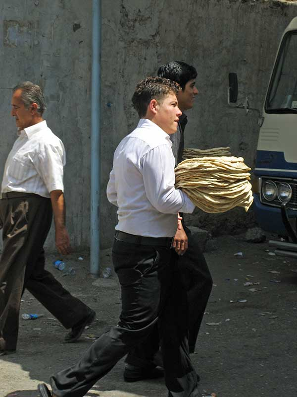 Young Iraqi man delivering bread