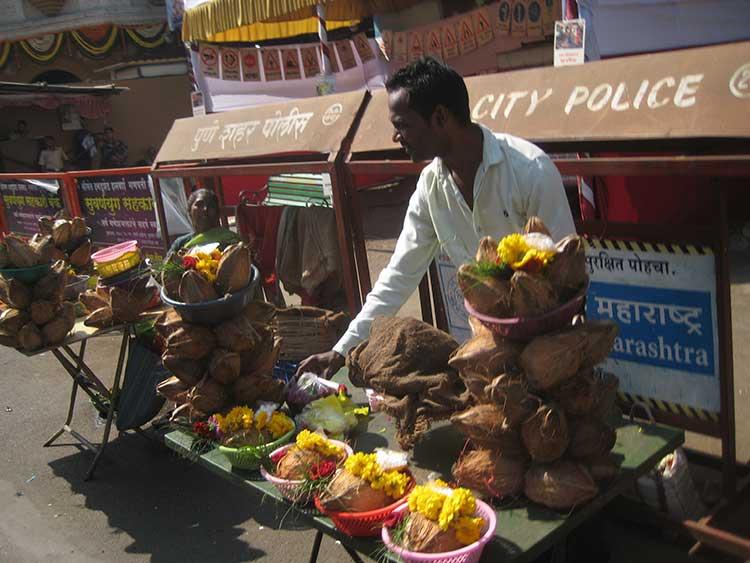Street vendor selling coconuts