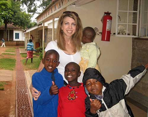 Dina with kids in Kenya