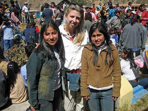 Dina with kids in Haiti
