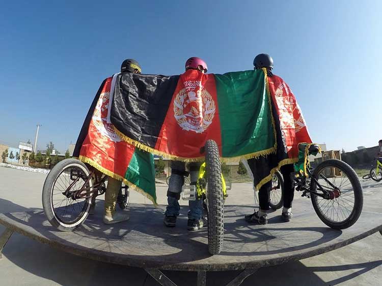 Teens with Afghan flag