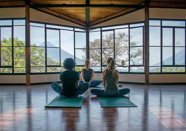 Doing yoga at earth lodge