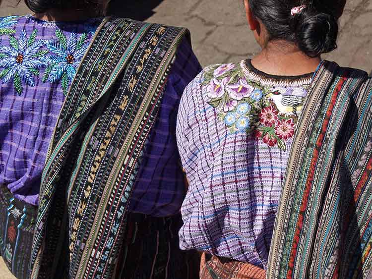 Women wearing Huipil