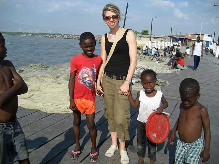 Dina with kids in Haiti