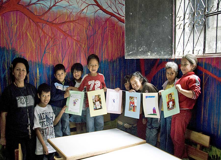 Youth holding art in Guatemala