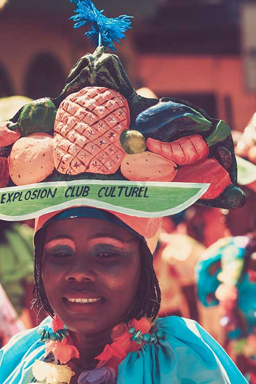 Haitian woman with fruit hat