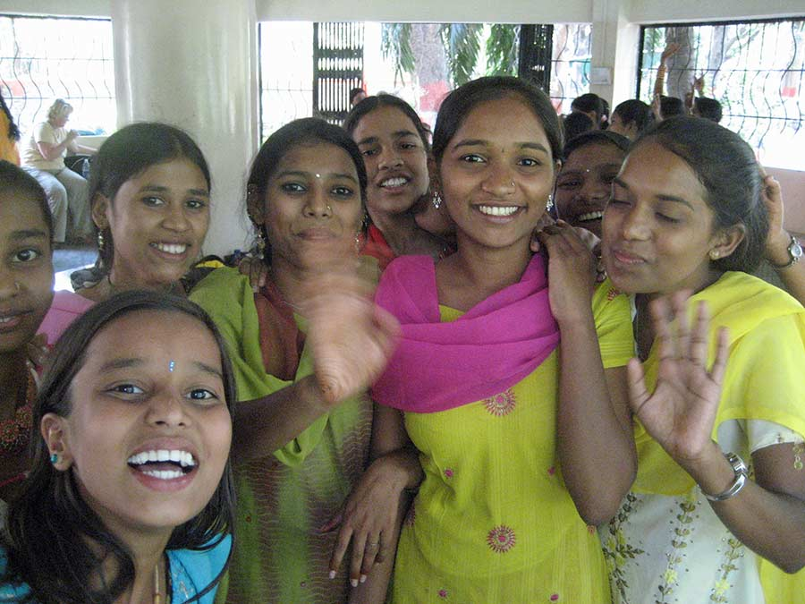 Indian girls waving