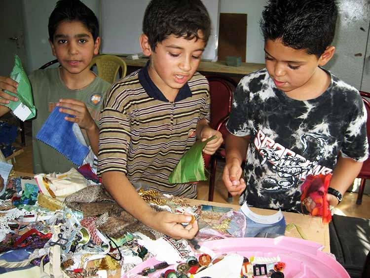 Boys selecting materials