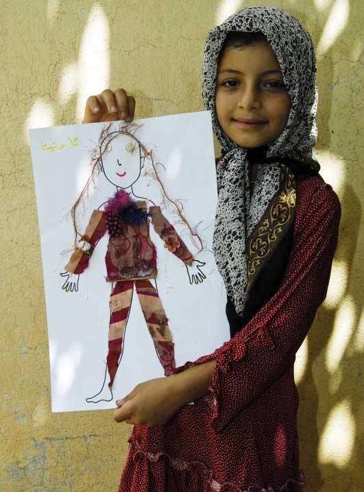 Iraqi girl with paper doll