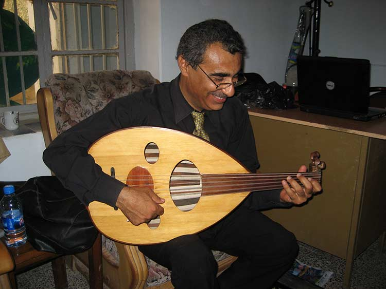 Iraqi man playing oud