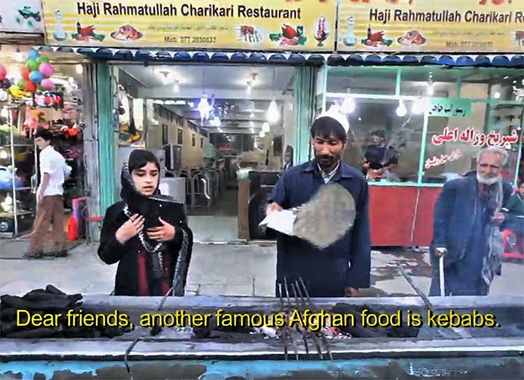 Karima asking questions to kebab vendor