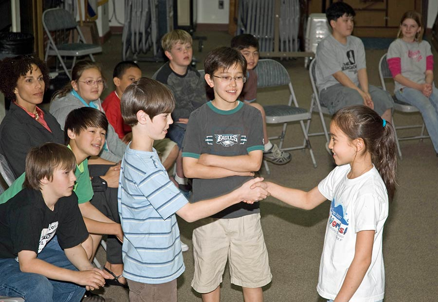 Students shake hands