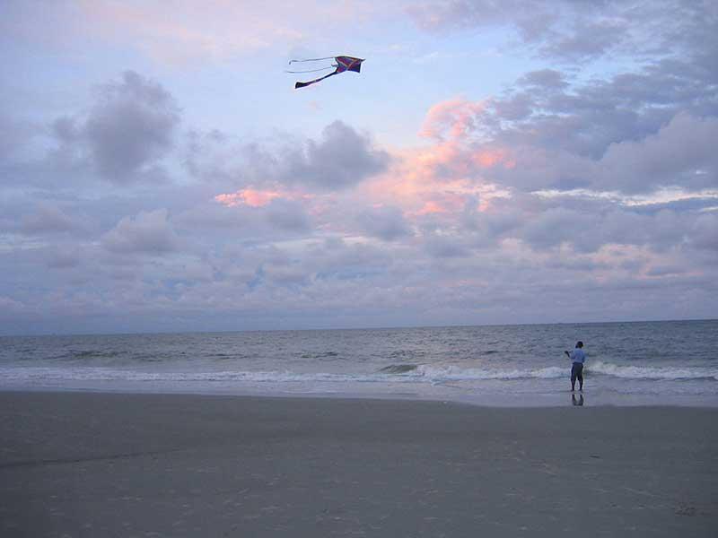 Flying kite on Haitian beach