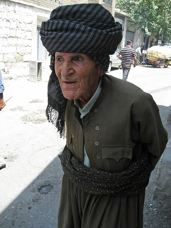 Elderly Kurdish man walking