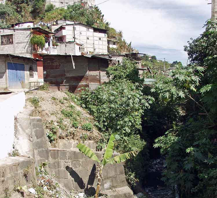 Ravine near slum houses