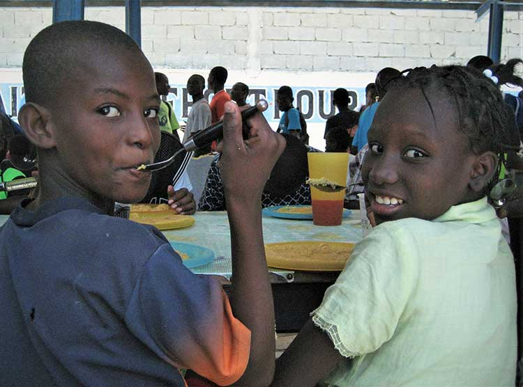 Haitian boys eating lunch