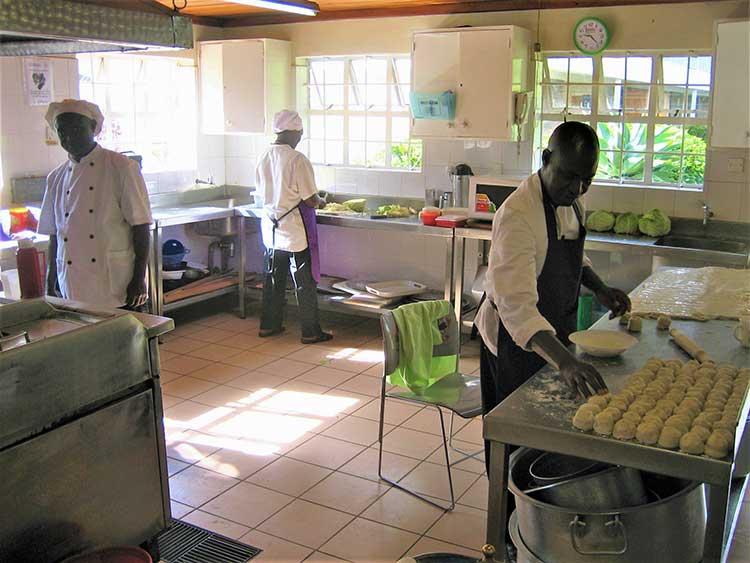 Chefs making lunch in kitchen