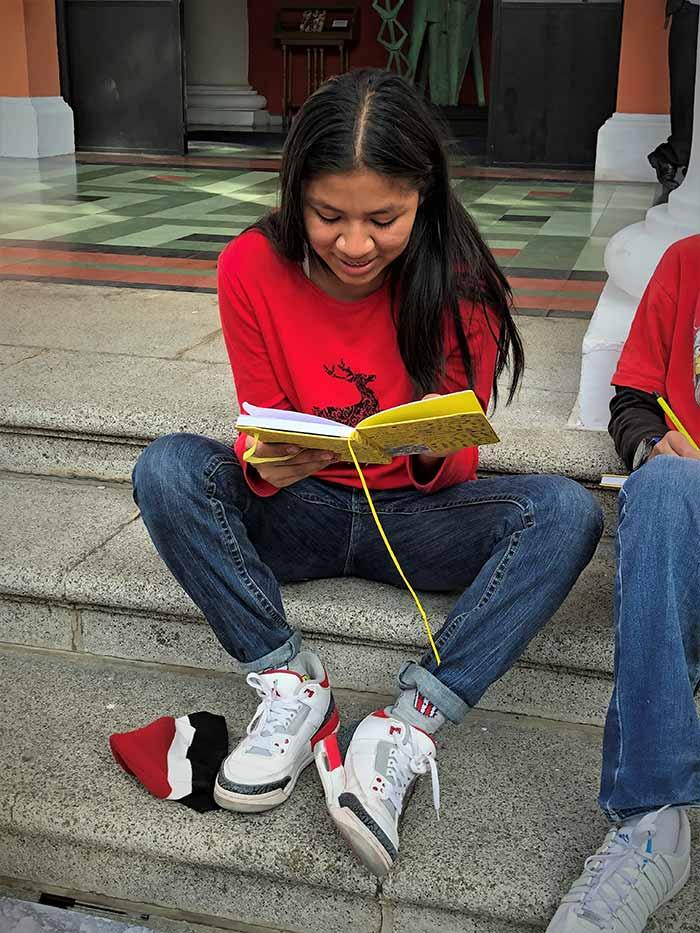 Guatemalan teen reading poem