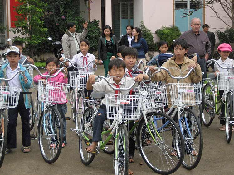 Kids receiving new bikes