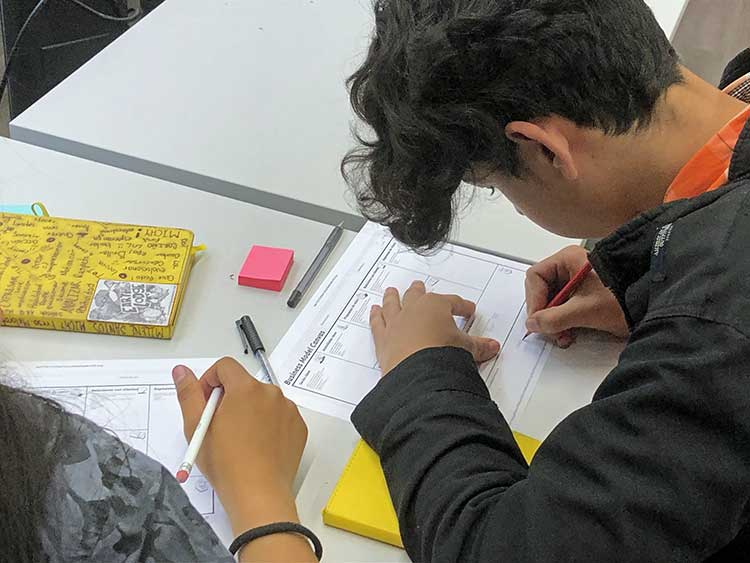Guatemalan boy taking notes in class