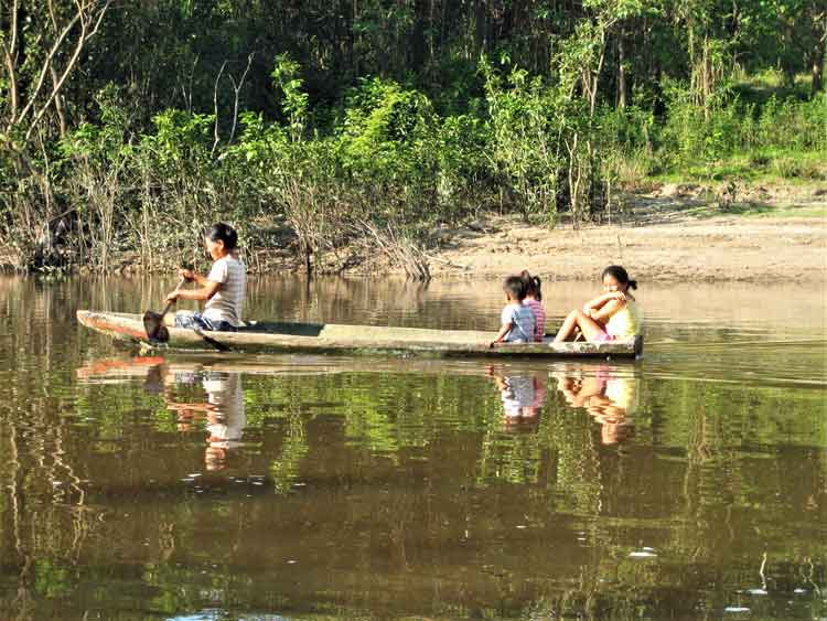 Kids riding in canoe