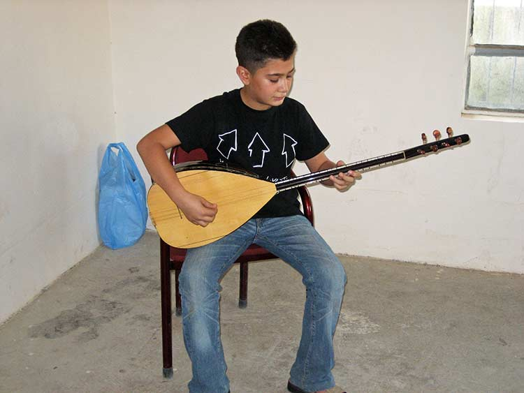 Iraqi boy playing oud