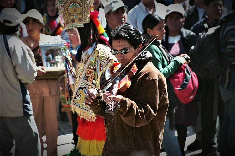 Peruvian man playing instrument