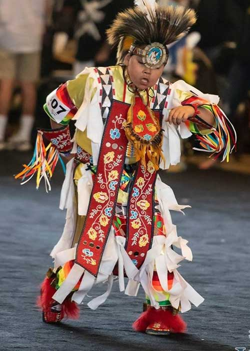 Native child performaning cultural dance