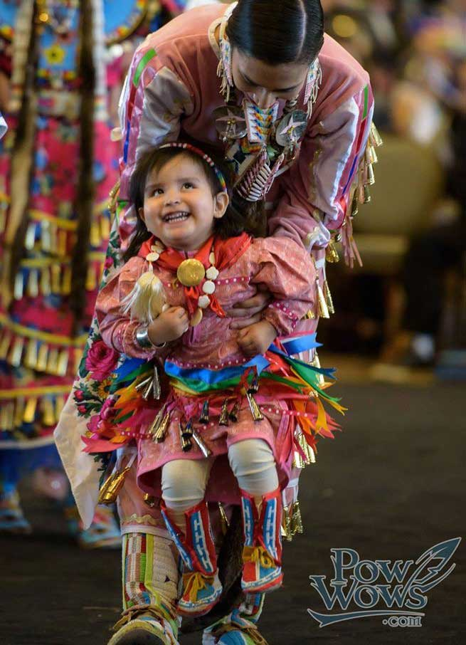 Native child and mother at pow wow