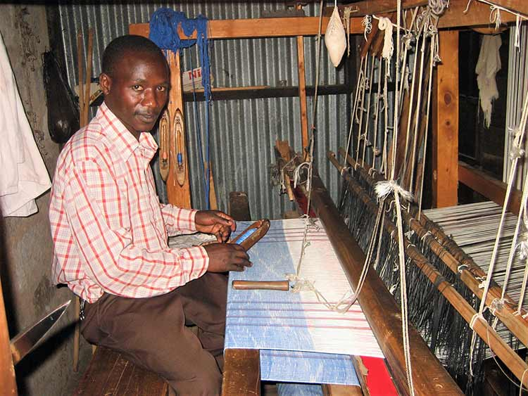 Man weaving rugs