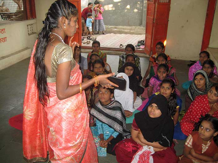 Indian girl teaching youth