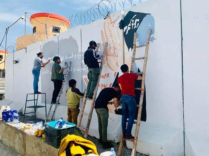 Afghans painting wall