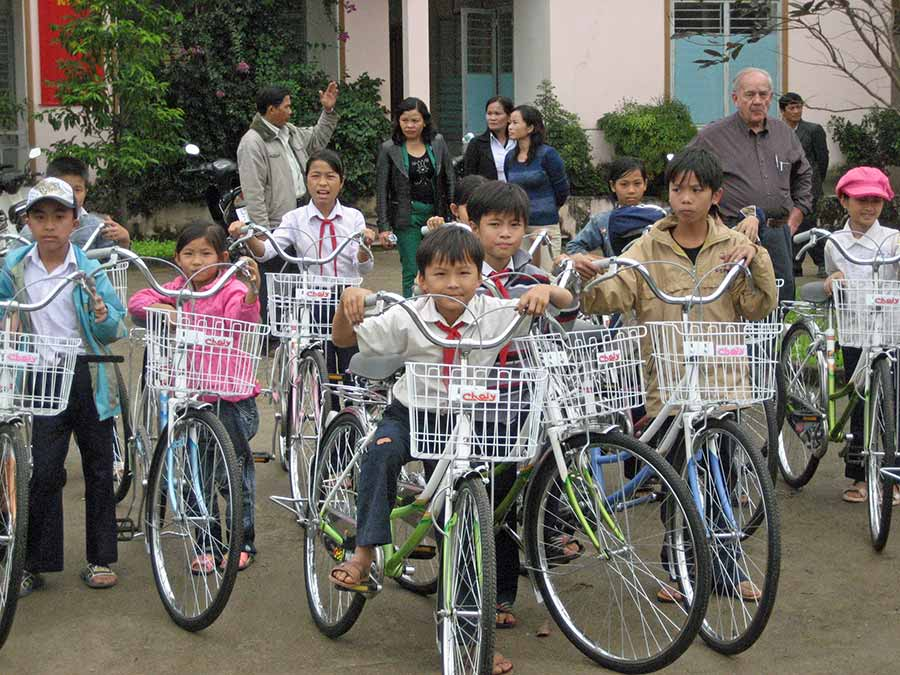 Kids in Vietnam on bikes
