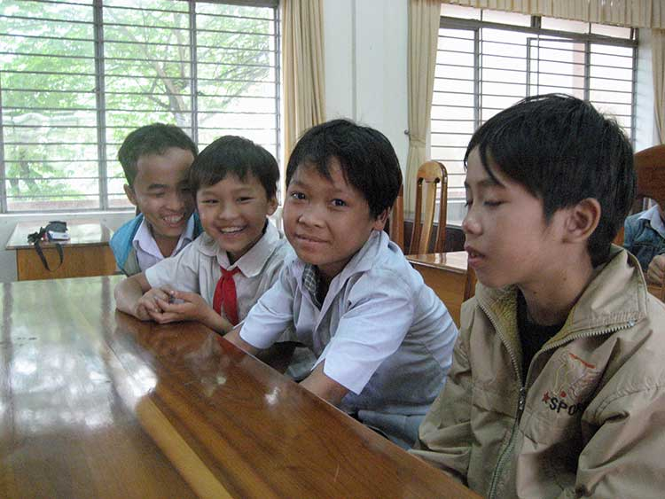 Vietnamese kids in desks