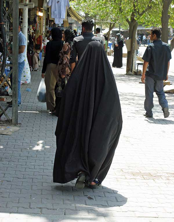 Iraqi woman walking in market