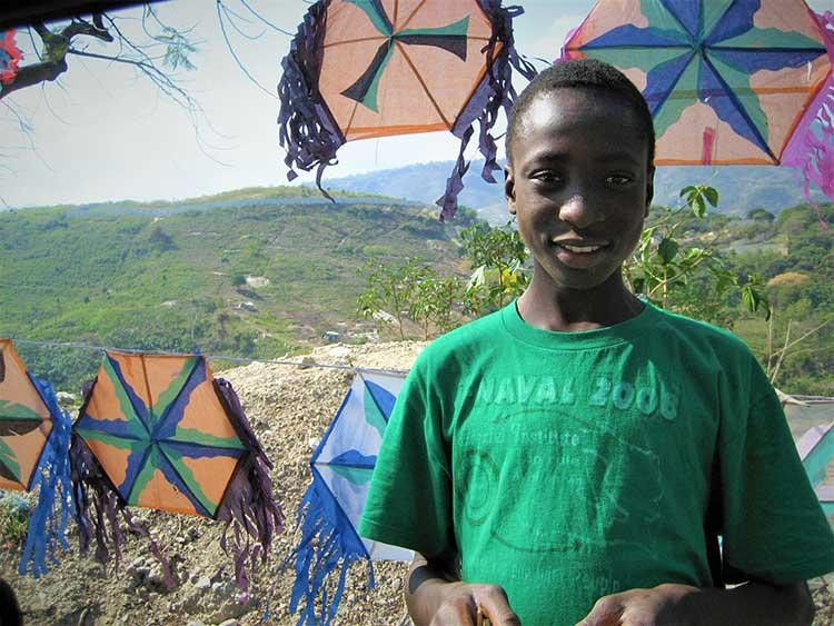 Boy selling kites